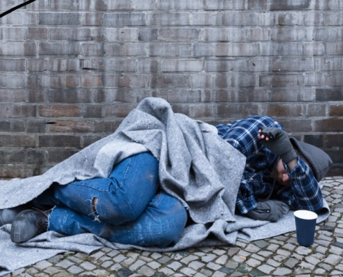 homeless man sleepinf