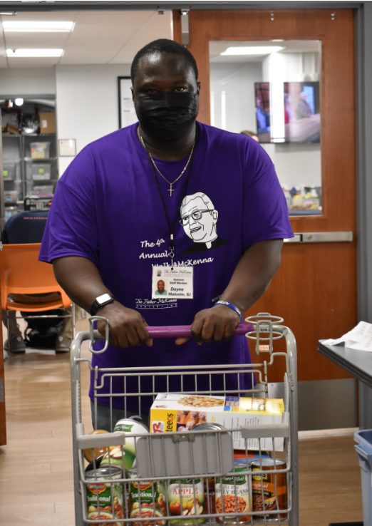 Dayne shopping for a Food Pantry Patron